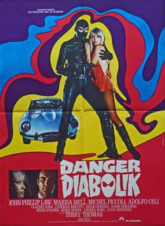 Cult stuff this……and a wonderful psychedelic poster complete with fetishistic, leather clad Diabolik, and the mini (almost) clad Marisa Mell. And what else would a Psychedelic Superhero drive, other than a silver E-Type ?