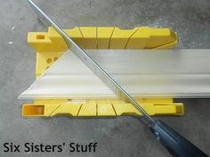 use this contraption and a hand saw to make picture frame molding for my dining room!  Summer project?! I think so!