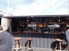 Really nice example of a shipping container transformed into a full service bar.