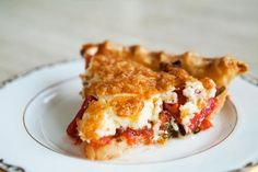 Fresh chopped tomatoes, basil and onions, topped with mixture of shredded cheese and mayonnaise, baked in a pie shell.