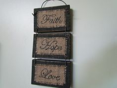 """3 Small Distressed, Black, Wooden Signs Connected With Wire Wall-hanging That Says """"Faith, Hope, Love"""" Written on Burlap in a Cursive Font on Etsy, $22.00"""