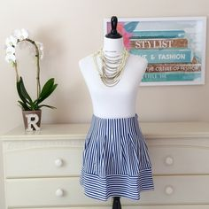 """Blue and White Stripe Flare Skirt Cute stripe flare skirt which you can style up or down! Side zipper closure.  Stats: 70% Cotton 30% Rayon Waist to hem: 16.5"""" Waist (laying flat): 13.5"""" (S)  Style Tips:  Casual: with your favorite shirt, jean jacket, sneakers  Dinner Out: with heels, sleeveless blouse, statement skirt Ya Los Angeles Skirts Mini"""