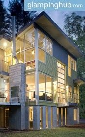 This lovely cottage is a 4 bedroom, 4 bath contemporary modern vacation home. Sitting high on its concrete pedestal, the guests are treated to the spectacular surroundings of old growth pines, oaks, and the hypnotic rhythms of the river.
