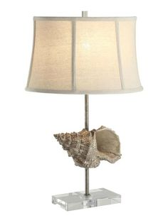 "Simple, yet so coastal chic, this 24.5"" tall Conch Shell Lamp perched on a lead crystal base, will add just the right finishing touch to your beach home."