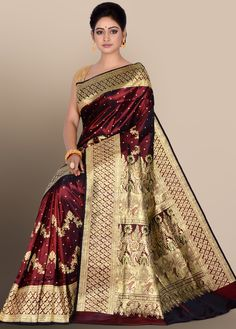 Glamourized enhanced with weaved patterns and buttis which is spread all over on the body. Decorative designed embellished pallu and border that beautifies the entire look. Comes with matching For assistance, please call / whatsapp at: 9836507444 Silk Saree Banarasi, Indian Silk Sarees, Kanchipuram Saree, Pure Silk Sarees, Indian Beauty Saree, Red Saree Wedding, Bridal Silk Saree, Wedding Dress, Maroon Saree