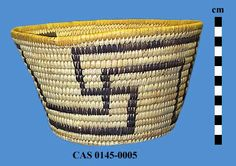 Pima-woven in coiled technique over a bundle foundation; Warp material is bear grass stems and primary weft material is  split yucca leaves; Designs are woven of black split devil's claw pods and consist of two parallel rectilinear zigzag lines around sides of basket, which cross each other at three points to form whirling log or swastika motifs; Final rim coil is wrapped in yellow undyed yucca leaves. Ht = 11.9, Dai = 21.6