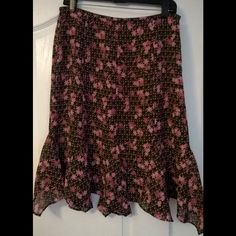 Ann Taylor Loft Skirt Selling a Ann Taylor Loft Polka dot and floral skirt. Brown and pink color with a touch of white. Ann Taylor Loft Skirts