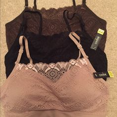 """Set of 3 Coobie Lace coverage bras new w/ tags The Coobie Lace Coverage Bra! Black, brown & nude. A beautiful lace panel across the front provides a perfect cover up for ones cleavage. Still a """"one size"""" item with adjustable straps and removable pads. Rave reviews are already coming in! If you want the comfort of our Scoopneck but a little more coverage then this is the one for you. Fits a 32A thru a 36D. The fabric is made of an ultra soft nylon and spandex blend. Two new with tags & one…"""