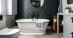 A beautiful bathroom featuring our Bampton bath by Day True