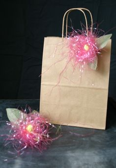Recycle plastic Easter grass into cute, messy, sparkly flowers to decorate gift bags and wrapped packages!