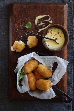 Cheesy Spanish Croquetas are a classic Spanish tapas style dish, these deep-fried bundles of cheese and ham are party favourites! Try the recipe here.