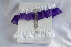 $ 38.00  Purple and white garters