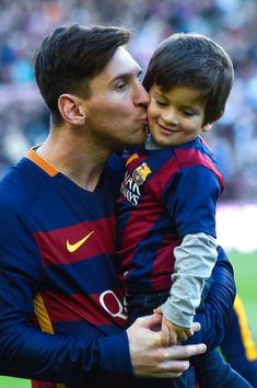 Lionel Messi of FC Barcelona kisses his son Thiago ahead of the La Liga match between FC Barcelona and Real Sociedad de Futbol at Camp Nou on November 28, 2015 in Barcelona, Catalonia.