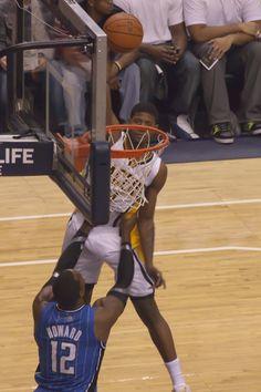 3e5272aad75f Paul George dunks over Orlando s Dwight Howard.  SeePGFly Dwight Howard