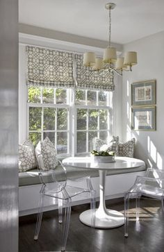 South Shore Decorating Blog - breakfast nook with ghost chairs and bench seating,  Saarinen tulip table base