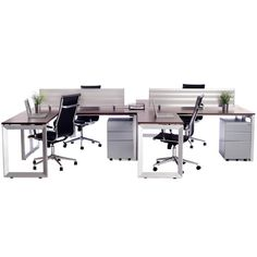 Workstation4! This functional set-up is bothstylish and functional. Sleek, flatsilver legs, rich brown teak topswith privacy dividers. Each desk complete wi