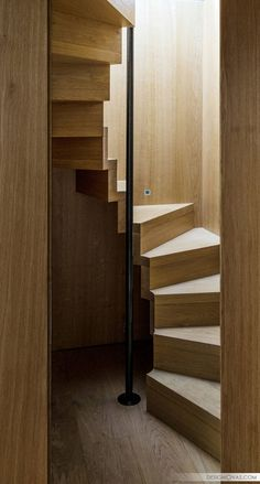 4. A ribbon staircase is a great idea for a small space because it's more vertical than a traditional staircase, it still has wide treads, and it creates a unique focal point in your home. Inspiration from Treppen