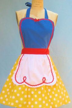 Cook Up A Magical Meal While Sporting A Whimsical Disney Apron. Dwarves and birds not included.