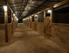 Whoa. Love the brick stall front in place of the typical wood! So pretty.>> don't love how tall the stall doors are!! The horses can't stick their heads out