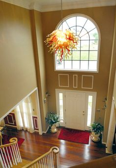 Two-story foyer in Perry Hall home includes a blown-glass chandelier.