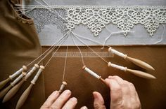 'Merletto a tombolo' Pillow lace or Bobbin Lace, is created using linen thread with 'fuselli' wooden bobbins, woven with pins on intricate designs. Anghiari lace is all woven from linen thread as apposed to cotton thread in most other regions of Italy. Filet Crochet, Crochet Lace, Irish Crochet, Crochet Edgings, Crochet Motif, Crochet Shawl, Crochet Pillow, Antique Lace, Vintage Lace