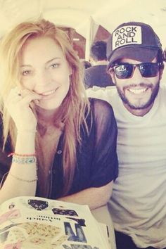 Lindsay Lohan with a friend July 31, 2014.   - MarieClaire.com
