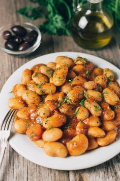 Greek Butter Beans Recipe - Gigantes Plaki (Vegan) - Real Greek Recipes - A traditional Greek butter beans (Lima beans) recipe. Cooked in a flavorful tomato & fresh herb sau - Easy Bean Recipes, Lima Bean Recipes, Vegetable Recipes, Vegetarian Recipes, Cooking Recipes, Healthy Recipes, Vegan Bean Recipes, Beans Recipes, Greek Dishes