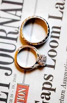 take a picture of the rings on a newspaper the day of the wedding