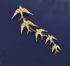 Gold and pearl graduated swallow brooch ca 1905