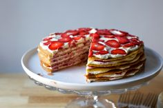 Graham cookie cake layered with a lightly cheesecake-d filling and fresh strawberries.