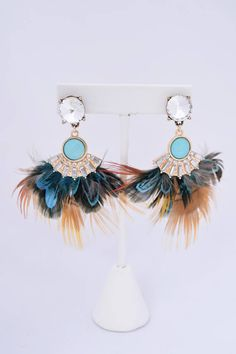 $36 Feathers and fringe are all the rave! These unique peacock feather earrings are one of a kind. Perfect for any little black dress.