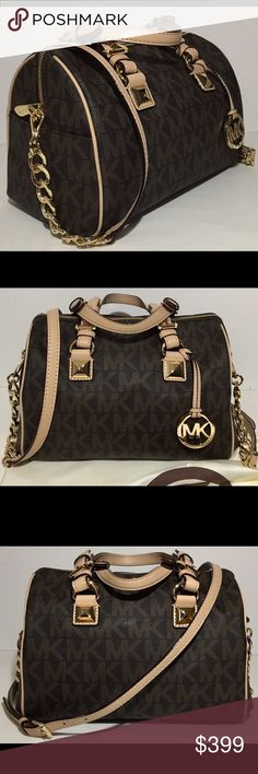 """Michael Kors Monogram Grayson Chain Satchel Medium Michael Kors Satchel and Dust Bag Brown PVC with MK logo print and buff leather trim. Golden hardware. Buckled top handles with pyramid stud detail; 5 1/2"""" adjustable drop. Removable chain/leather shoulder strap. Hanging MK logo circle charm. Zip top closure. 9 1/2""""H x 12""""W x 6 1/2""""D. Please view last photo for minor wear on bottom corners. Michael Kors Bags Satchels"""