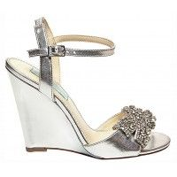 The Dress wedding wedge shoes by Betsey Johnson are silver metallic wedding wedges with a stunning rhinestone embellished bow in true Betsey