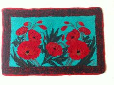 approx. 2'x3  Poppies made by Carmen Hall using RC speed tufting tool using assorted recycled clothing and the background was a blanket finished July 2015