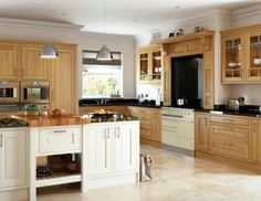 Oak wood In-Frame kitchen in a traditional raised panel style.