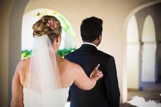 Bride with wedding updo hairstyle and veil taps on shoulder of groom in black suit for wedding first look at The Crosby, Rancho Santa Fe, San Diego, CA. http://abounaphoto.com #weddings   #bride   #weddingdress   #weddinghair   #firstlook   #weddingphotography   #sandiego