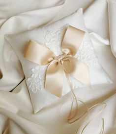 This romantic ring bearer pillow is stunning in ivory and champagne. The pillow is made with ivory bridal satin. The luxurious swiss bridal satin Ring Bearer Pillows, Ring Pillows, Wedding Pillows, Ring Pillow Wedding, Blush Silver Wedding, Champagne Ring, Lace Ring, Wedding Accessories, Marie