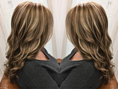 The fall blonde is a blend of natural blonde/ cool brown shades to achieve this bronde color. Bayalage and baby light highlights for the blonde and a cool brown base with natural brown low lights. This long hair was curled on a Paul Mitchell clipless curling iron