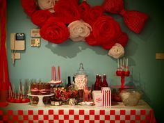 Sweets table above decorated with crepe paper roses and inside wired fabric rose. For my daughter's 21st retro themed party