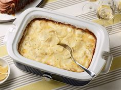 Slow-Cooker Scalloped Potatoes : The best part about this creamy potato side is that you can serve it straight out of the slow cooker — no need for replating. We added a little bit of flour to help thicken and stabilizethe cream. Keeping the potatoes thin is the secret to this recipe's success, so try using a mandoline to slice them evenly.