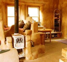 Cob home - I love the wood burning stove nook!