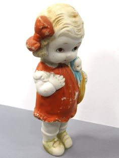 Hey, I found this really awesome Etsy listing at https://www.etsy.com/listing/254767725/bisque-girl-with-doll-made-in-japan