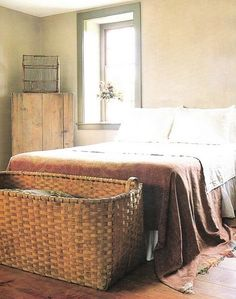 love this basket at the end of the bed.  perfect for throwing those extra pillows in at night. Biggest basket I have ever seen!