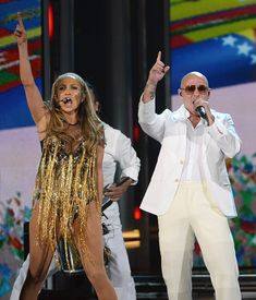 Pitbull Photos - Singer/actress Jennifer Lopez (L) and recording artist Pitbull perform onstage during the 2014 Billboard Music Awards at the MGM Grand Garden Arena on May 18, 2014 in Las Vegas, Nevada. - 2014 Billboard Music Awards - Show