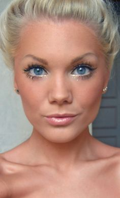 Linda Hallberg spring / summer makeup look. Glowing bronzed skin and bright eyes with a hint of sparkle and light pink nude lips.