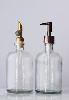 The Self Pour Spout Recycled Glass Dispenser is a handsome apothecary style recycled glass dispenser featuring a corked self-pour spout in stainless silver or gold that will dispense your favorite bath oils or olive oils in style. Coordinates beautifully with any of our recycled glass soap dispensers.   THIS DISPENSER IS MOST APPROPRIATE FOR COOKING OILS AND BATH OILS. THIS DISPENSER IS NOT INTENDED FOR SOAPS.  • 13.5 fluid oz • Stainless metal self pour spout available in Silver or Gold •…