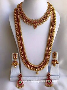 South Indian Wedding Imitation Jewellery set consisting of Necklace, Long haram and two sets of earrings all studded with kemp rubies and emeralds.