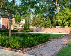 Outdoor Spaces Landscape Design for privacy with brick and iron fencing | ... columbia sc raised brick border along herringbone brick paths