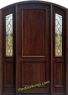 Arched door. Refinished in cherry.    www.thedoorkings.com