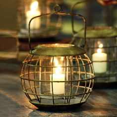 Traverse through any terrain with this stylish antiqued lantern.  Sculpted from iron and equipped with a handle for hanging, we picture this lantern lighting up your bathroom with a soothing glow.